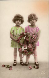Two Young Girls holding Flower Basket