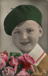 Young Boy in Green Beret holding Roses