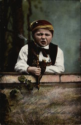Young Boy in Native Costume Smoking