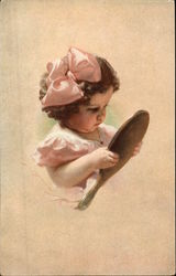 Little Girl in Pink Bow looking in a Hand Mirror