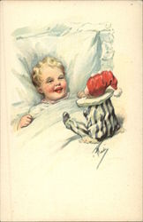 Small Child in Bed Laughing at a Clown Doll