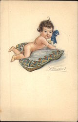 Baby with Blue Bow Lying on Pillow