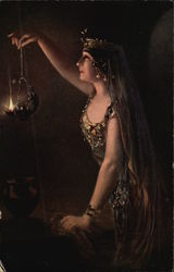 Woman in Rhinestones Holding Lit Lamp