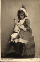 Young Girl sitting on Barrel looking into a Stein