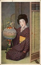 Geisha Girl Kneeling with Paper Lantern