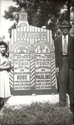 "Man and Woman next to Jewish Headstone ""Brenner"""