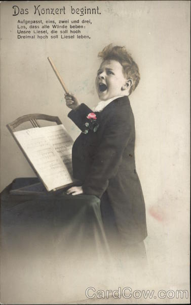 The Concert Begins - Young Boy Conducting Music