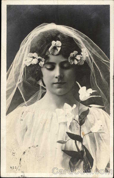 A Bride Wearing Veil with White Flowers Marriage & Wedding