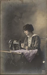 Woman Working At A Sewing Machine