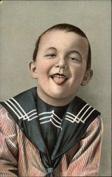 Portrait of Young Boy in Sailor Outfit Sticking Out His Tongue