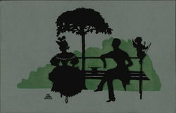 Silhouette of Couple Sitting on Bench with Cupid Silhouettes