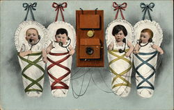 Four Babies Hanging on the Wall by the Telephone