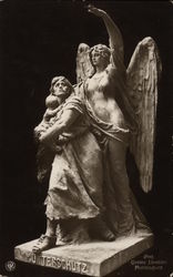 Statue of Angel Protecting a Mother and Child