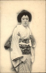 Photograph of Geisha Girl Holding Large Knife