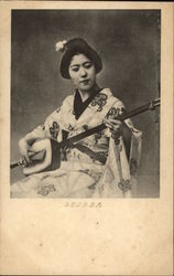 Photograph of Geisha Girl Playing Stringed Instrument