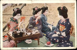 Four Geisha Girls Kneeling with Food & Drink