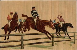 Jockies on Horses Jumping a Fence