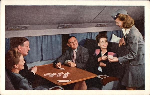 United Air Lines Stewardess Serving Passengers Aircraft