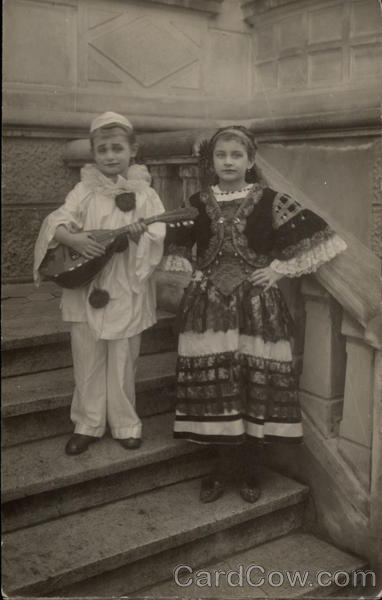 2 Children in Costume for playing Music and Dancing