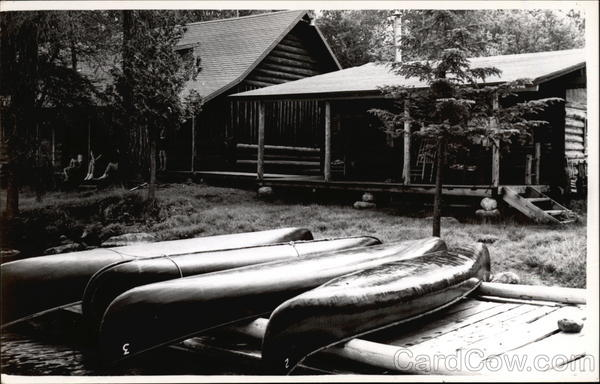 Log Cabin with Four Canoes Canoes & Rowboats