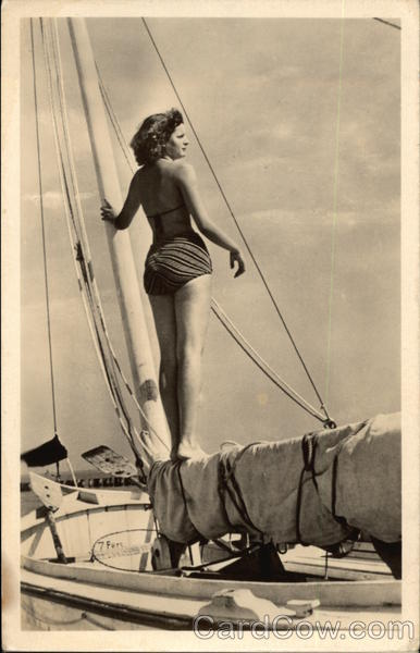 Photograph of Bathing Beauty standing on Sail Mast