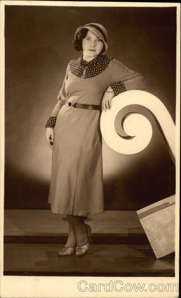 A Woman modeling a Dress and Hat Women