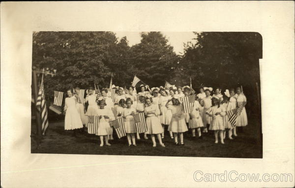 Group of Girls in White holding American Flags Patriotic