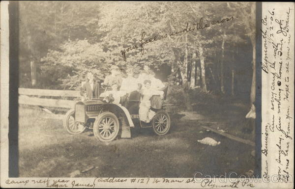 A Family in an Automobile of 1906 Cars