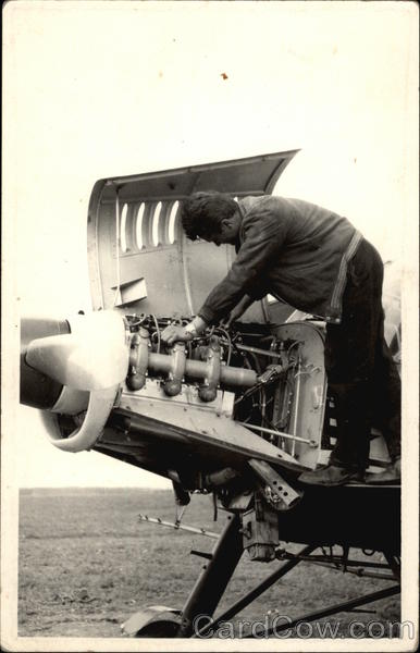 Mechanic working on Aircraft Engine