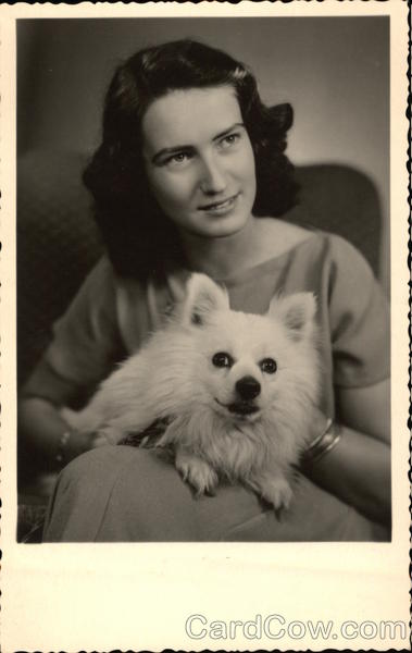 Brunette Woman holding White Dog Dogs