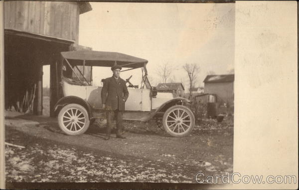 Man Standing in Front of Model T Ford Cars