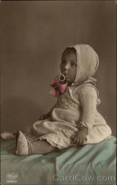 Portrait Photograph of Baby Girl with Pacifier Babies