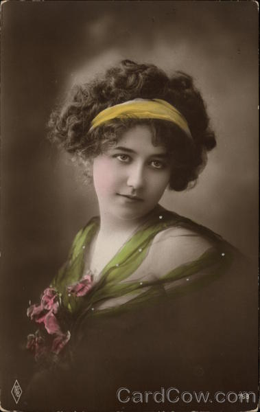 Portrait of Brunette Woman in Green Dress & Yellow Hair Ribbon