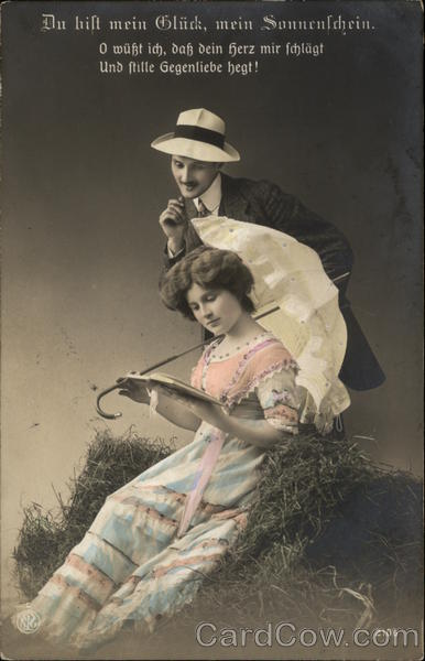 A Man Reading over a Woman's Shoulder Couples