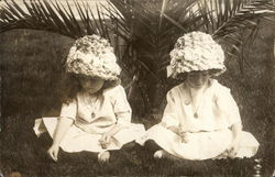 Two Girls, Fancy Hats, Sitting in Grass