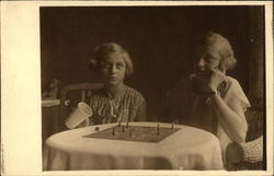 Two Girls playing a Board Game