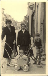 Woman and Chjldren with Stroller and Bike