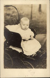 Vintae Photograph Infant Wearing White sitting in a Black Pram