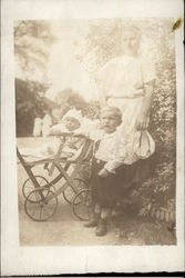 A Mother, Toddler, and Baby in a Buggy