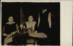 Two Dressmakers at Sewing Machine