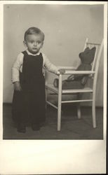 Vintage Photograph of Young Boy standing beside Chair with Teddy Bear
