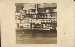 Man Standing Behind Grocer's Counter