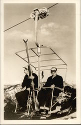 Two Men Riding Ski Lift