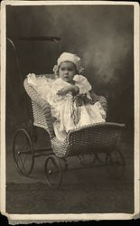 Portrait Photograph of Baby in Wicker Stroller