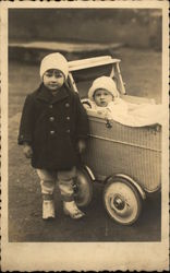 Photograph of Young Children with Wicker Stroller