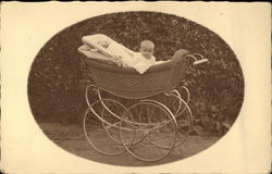 Portrait Photograph of Baby in Wicker Buggy