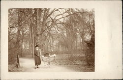 Woman with a Child in a Pram on a Country Lane