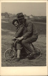 Man & Boy on a Tiny Bicycle