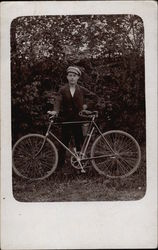 Vintage Photograph of Young Man with a Bicycle