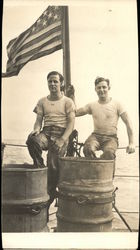 Two Men on a Boat with a USA Flag